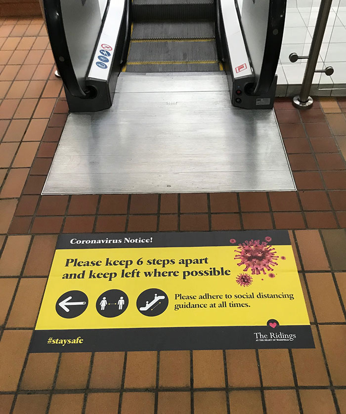 Coronavirus floor graphic - escalator
